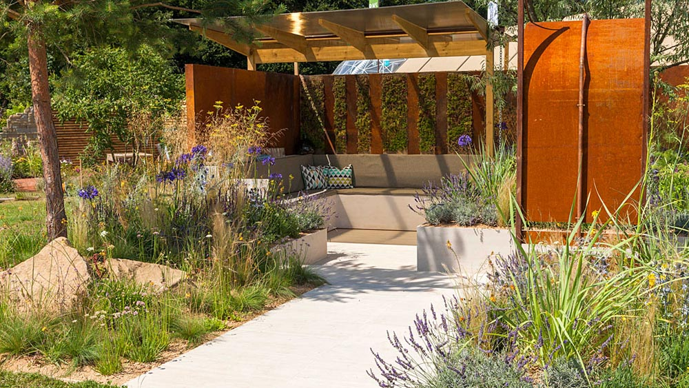 Chaos to Coastline Coastal Garden  Young Planting Designer	: Ben Poulter Young Landscape Contractor: Elliott Hood  Award	: GOLD Medal & BEST RHS YOUNG Landscape Contractor & Planting Designer Garden